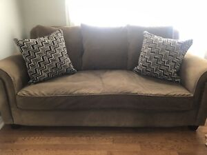 Chocolate brown couch and love seat
