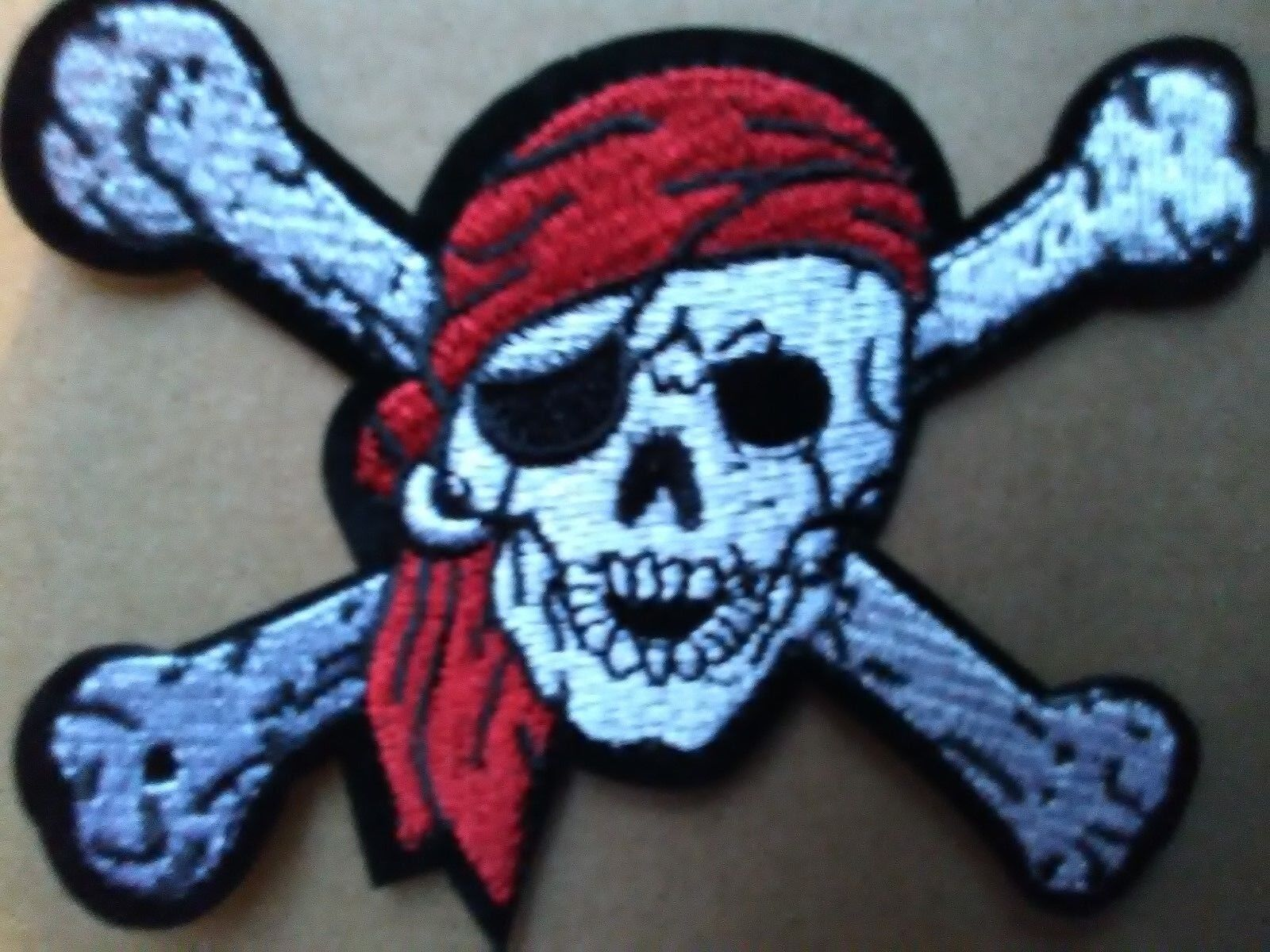 PIRATE SKULL AND CROSSBONES  BIKER STYLE PATCH. SEW OR IRON ON  PATCH