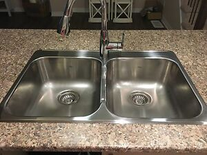 Brand new, stainless steel double sink.