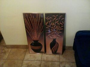 two vase picture frames