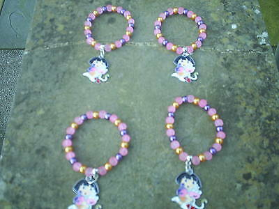 DORA THE EXPLORER & BOOTS GIRLS FOUR BRACELETS WITH CHARMS ONLY £3.57