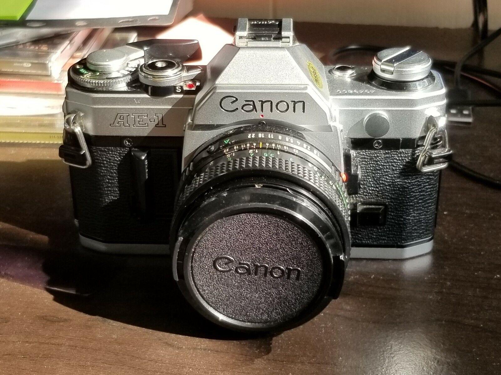 Canon AE-1 Program 35mm SLR Film Camera With 50 Mm Lens Kit - $150.00