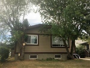 5 Bed, 2 Bath house with huge yard in Lacombe. Hurry & Call NOW