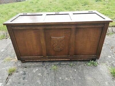 antique blanket box carved emblem on front