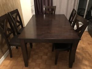 Leon's brown Wooden table with 6 chairs dining seats.