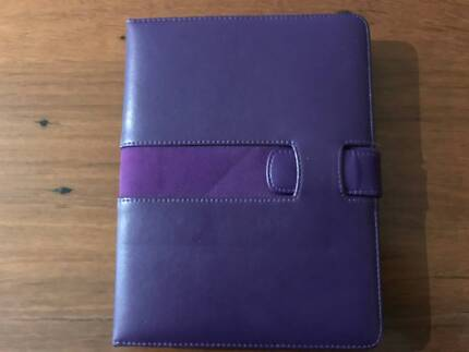 Kindle with quality leather case and reading light.