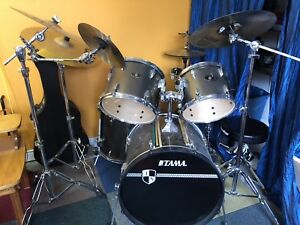 Tama drum set with 4 piece symbol