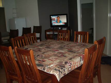 Solid wood square dining table with 8 wooden chairs. Pimlico Townsville City Preview