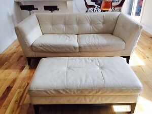White leather Natuzzi sofa and ottoman