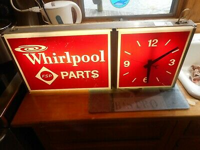 VINTAGE LIGHTUP WHIRLPOOL PARTS ADVERTISING SIGN AND CLOCK 25 1/2 IN X 10 1/4 IN