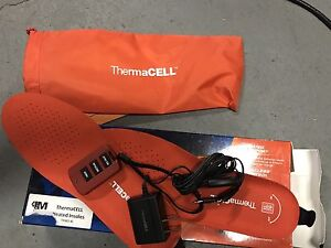 Thermacell heated insoles/ brand new