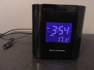 Electrohome alarm clock with laser