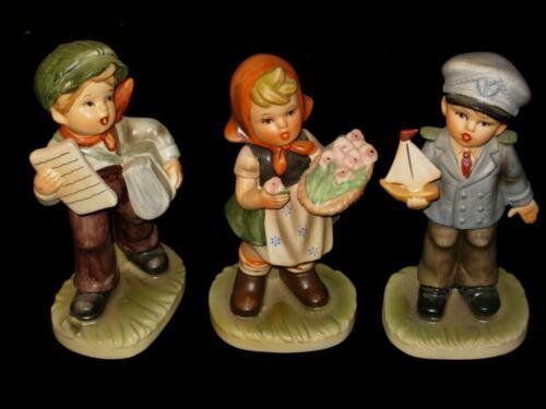 VTG-Lot of 3(FAUX) HUMMEL FIGURINES (Girl w/flowers, boy w/boat, boy w/paper)