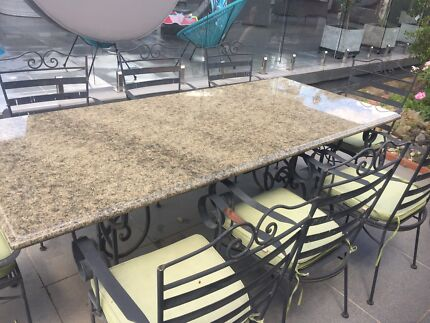 Granite stone top outdoor setting with 8 chairs