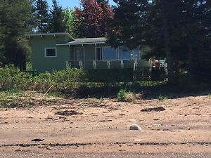 Beach front cottage for sale Brule