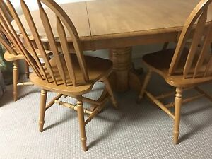 Solid oak table with leaf and four chairs