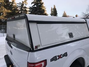 Raider canopy F-150 6'5 box.  Best offer takes it.