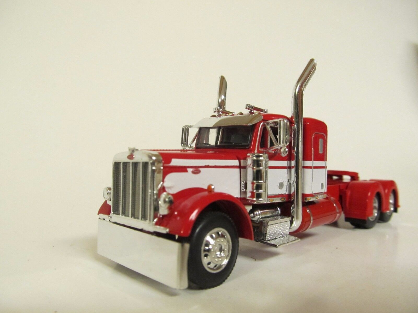 DCP 1/64 SCALE 379 PETERBILT SMALL BUNK RED WITH WHITE  SEMINOLE STRIPE