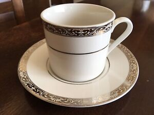 Eight Flat Cup and Saucer Sets