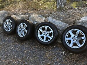 4 chrome rims with studded snowtires