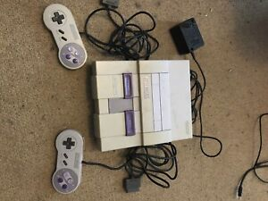Super Nintendo 2 controllers and 4 games