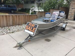 12 ft aluminum boat and motor, complete ready for water