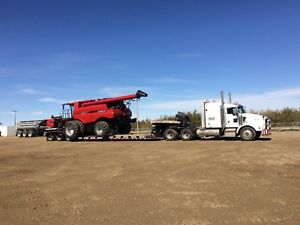Farm equipment hauling and air drill towing