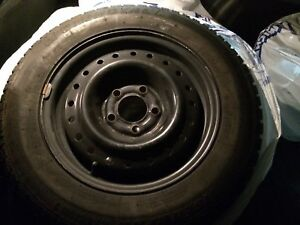 """15"""" Tiger Paw ice & snow tires with rims"""