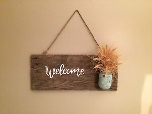 Homemade rustic welcome sign