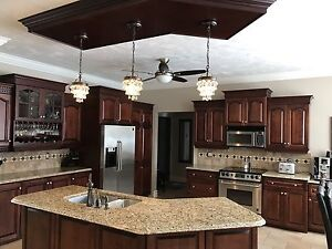 Custom kitchen with granite counters and stainless appliances