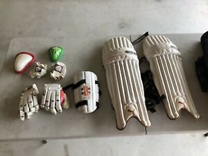 Cricket pads, gloves, great bag, arm guard, boxes