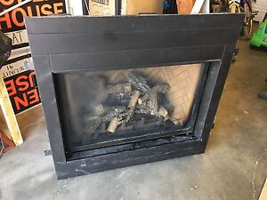 Gas fireplace insert with wood mantle