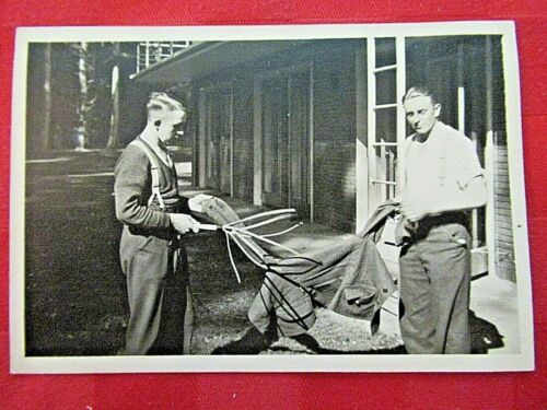 WWII Original German Photo Combat Soldiers using clothing whip to clean clothes