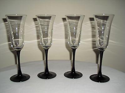(4 Black Stem Tulip Shaped Flared Champagne Flutes / Wine Goblets)