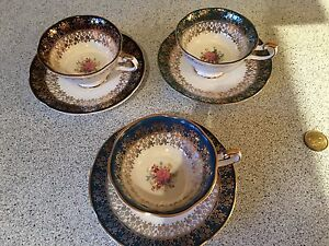 3 Fine Bone China cups. Made in England. Storage bag included
