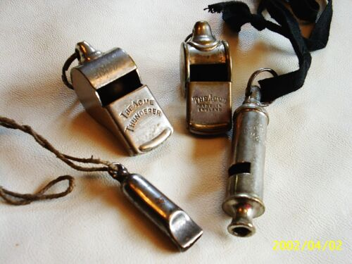 A collection of vintage Acme whistles plus a tiny one.