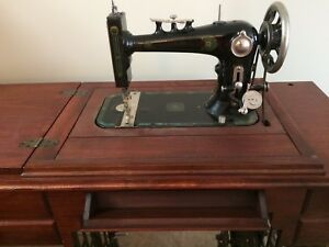 Antique Sewing Machine Refinished.  Offers Accepted
