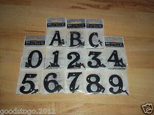 Black plastic door numbers
