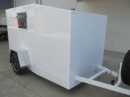 Enclosed Camper style trailer.