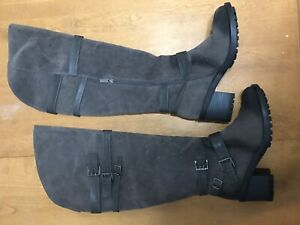 Knee high grey and black discoloured boots