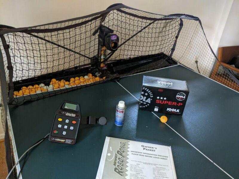 Newgy Robo Pong 2050 table tennis robot, includes balls and manual
