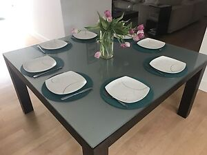 Glass dining table from Inspiration.