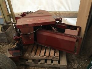 Square bale thrower