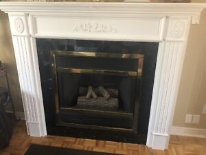 White fireplace Mantle with black marble