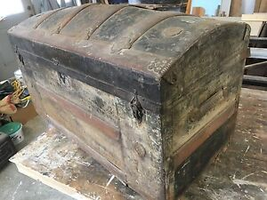 Antique round top trunk