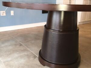 Kitchen table with leather wrapped base