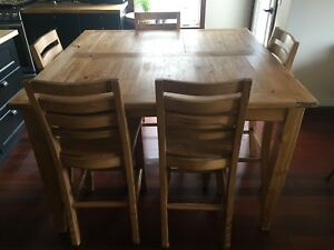Solid pine counter height dining table with 8 chairs