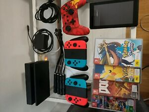 Nintendo switch with 5 controllers and games