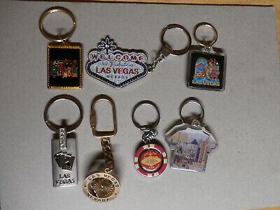 LOT OF 7 SOUVENIR KEY RINGS - LAS VEGAS - NEW AND PRE OWNED * FREE SHIPPING *