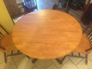 "38"" drop leaf round dining table with 2 chairs."
